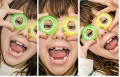 A menina bonita está olhando através dos círculos de um escocês imagens de stock