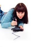 Menina bonita excitedly, jogando os jogos video Fotografia de Stock