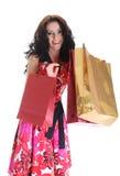 menina bonita feliz de cabelos compridos com saco de compra Fotografia de Stock Royalty Free