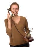Menina bonita feliz que fala no telefone retro Foto de Stock