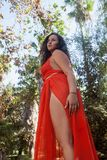 Menina bonita fora em um vestido Imagens de Stock Royalty Free