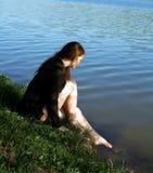 Menina bonita na água na costa foto de stock royalty free