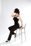 Menina bonita na cadeira Imagem de Stock Royalty Free