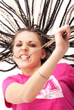 Menina bonita na cor-de-rosa que morde seu cabelo Imagem de Stock