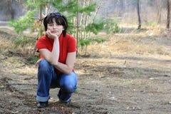 Menina bonita na floresta da mola Imagem de Stock Royalty Free