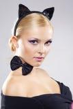 Menina bonita na imagem de um gato Imagem de Stock Royalty Free