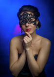 Menina bonita na máscara Fotografia de Stock