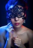 Menina bonita na máscara Imagens de Stock Royalty Free