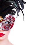 Menina bonita na máscara vermelha do carnaval Imagens de Stock Royalty Free