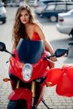 Menina bonita na motocicleta Fotos de Stock