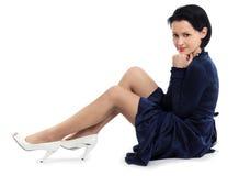 Menina bonita na obscuridade - vestido azul Fotos de Stock Royalty Free