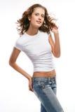 A menina bonita nas calças de brim Fotos de Stock