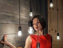 Menina bonita nas luzes do fundo Imagens de Stock