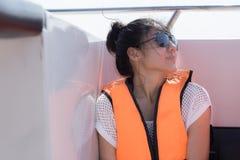 Menina bonita no barco da velocidade imagem de stock