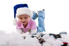 Menina bonita no chapéu de Santa Fotografia de Stock Royalty Free