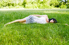 Menina bonita no jardim Imagens de Stock Royalty Free