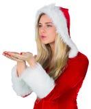 Menina bonita no sopro do equipamento de Santa fotografia de stock royalty free
