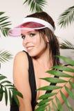Menina bonita no tampão cor-de-rosa Imagem de Stock