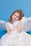 Menina bonita no vestido branco Fotografia de Stock Royalty Free
