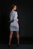 Menina no vestido cinzento Imagens de Stock