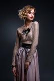 Menina bonita no vestido de seda do laço foto de stock royalty free