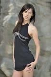 Menina bonita no vestido preto Imagens de Stock Royalty Free