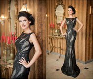 Menina bonita no vestido preto elegante que levanta na cena do vintage Mulher bonita nova que veste o vestido luxuoso Brunette se Imagens de Stock Royalty Free