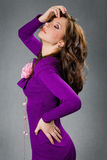 Menina bonita no vestido roxo Imagem de Stock