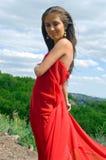 Menina bonita no vestido vermelho Imagens de Stock Royalty Free