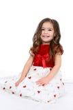 Menina bonita no vestido vermelho e branco Imagens de Stock Royalty Free