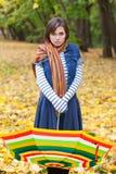 Menina bonita nova com guarda-chuva listrado Fotos de Stock Royalty Free
