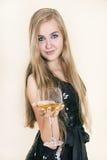 Menina bonita nova com um vidro do vinho Imagem de Stock Royalty Free