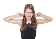 Menina bonita nova do adolescente que obstrui as orelhas com isolado dos dedos Imagens de Stock Royalty Free