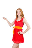 Menina bonita nova em apontar vermelho do vestido foto de stock royalty free