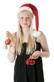 Menina bonita nova em um chapéu de Santa fotos de stock royalty free