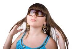 A menina bonita nova em um fundo branco Fotografia de Stock Royalty Free