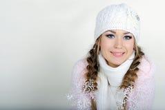 A menina bonita nova em um tampão branco Fotografia de Stock Royalty Free
