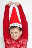 A menina bonita nova em um tampão de ano novo Fotografia de Stock
