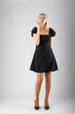 A menina bonita nova funde para fora bolhas de sabão Imagens de Stock