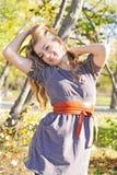 A menina bonita nova na madeira do outono Fotografia de Stock Royalty Free