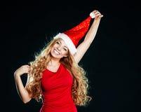 Menina bonita nova no chapéu de Santa Imagens de Stock Royalty Free