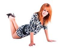 Menina bonita nova no vestido no assoalho Imagem de Stock Royalty Free