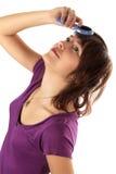 A menina bonita penteia o cabelo Fotos de Stock Royalty Free