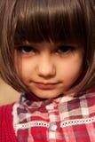 Menina bonita pequena com olhos expresive Imagem de Stock