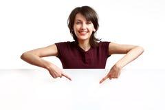 Menina bonita que aponta seus dedos para baixo Imagens de Stock
