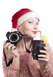 Menina bonita que bebe do copo da lente isolado Foto de Stock Royalty Free