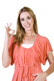Menina bonita que dá o sinal APROVADO Imagens de Stock Royalty Free