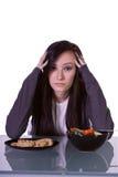 Menina bonita que decide que comer Fotografia de Stock