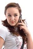 Menina bonita que fala no telefone Fotos de Stock Royalty Free