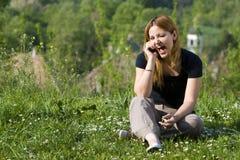 Menina bonita que fala no telefone Foto de Stock